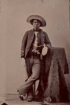 c. 1860-80, studio portrait of an unidentified soldier with buffalo hide and gun. (Yale University, Beinecke Rare Book and Manuscript Library, Photographs of Afro-American Soldiers Collection. *s*