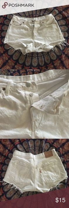 White worn Levi shorts Hand cut, distressed mostly at the bottom, some distressed parts on the main body. Sparkling white 501. Button fly great hardware Levi's Shorts Jean Shorts