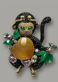 MULTI-COLOUR JADEITE, COLOURED SAPPHIRE AND DIAMOND 'MONKEY' BROOCH, MASON TSAI Modelled as a whimsical monkey holding a peach, set to the centre with a heart-shaped yellow jadeite, embellished by a jadeite plaque of emerald green colour, the head set with circular-cut yellow sapphires accented by eyes set with jadeite cabochon of emerald green colour, the limbs set with black diamonds, decorated by oval sapphires and diamonds.