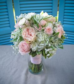 Wedding flowers at the Marshall House, Officer's Row, Vancouver, WA.  Bridal bouquet featuring pink garden spirit garden rose, white roses, pink roses, euphorbia, baby's breath, and hydrangea.  Chickabloom Floral Sutdio - serving Vancouver, WA and Portland, OR areas.