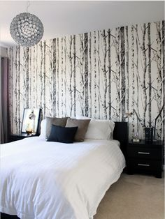 EH61008 - Contemporary Black and White Birch Tree Wallpaper from Eco Chic - Distributed by Seabrook Wallcovering.  This pattern appeals to homeowners who tend to be nature lovers.  This black and white pattern strikes a cord with folks who really enjoy the outdoors but like modern room decor. Have your cake and eat it two.