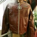 A motorcycle jacket made from reclaimed Cadillac upholstery and parts   WHAT?!