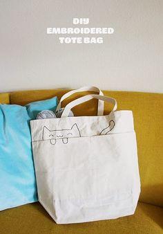 Decorar bolsas con la figura de un gato bordado
