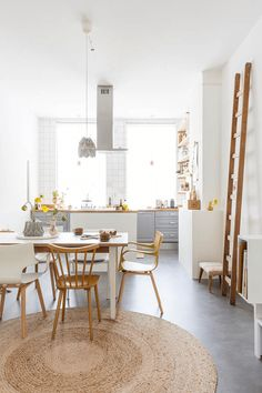 This is the beautiful Dutch home of Tinta Luhrman. Tinta is a contributor on The Junior Daily, one of the best place to find cool kids stuff and inspiration. Her home is nothing short of stunning with an abundance of white walls, light wood and pastel colours. I love this light kitchen paired with a pastel grey and bright yellow flowers! What do you think?