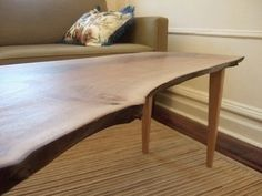 Live edge coffee table with tapered legs. Made to your specific dimensions.