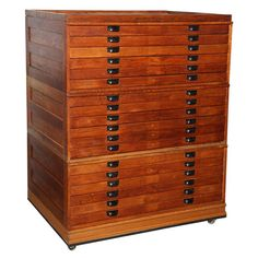 Large Oak Flat File USA early 20th Century Large 18 drawer Flat File on casters. Good for flat art storage. Total of 5 sections: 1 top, 1 bottom & 3 mid sections (w/6 drawers ea.)