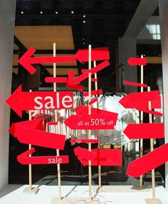 Sale time window display... the arrows point, of course, to the door of your consignment or resale shop, suggests Kate Holmes of auntiekate.wordpress.com