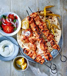 Turkish chicken shish Turkish Shish Kabob – Marinated meat, spices, sharp pickles and citrus, offset with a hint of smokiness… The chicken shish is hold-me-back good. Turkish Kebab, Turkish Chicken Kebab, Turkish Mezze, Turkish Grill, Turkish Recipes, Ethnic Recipes, Romanian Recipes, Scottish Recipes, Kabobs