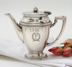 As a reminder from your Mom - our trip to the Palmer House, Chicago when you were 10 years old.... A silver teapot from there to help you  remember that I took you to high tea... so you would learn etiquette before the world told you it shouldn't exist. It should - it does. It's called Civility. SLH