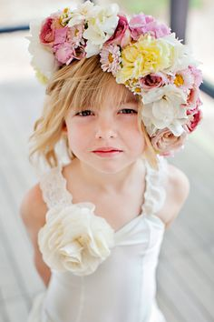 Flower hat is an excellent idea!  http://www.theknot.com.au/wedding-vendors/ceremony/flowers/nsw/sydney/chanele-rose-flowers-styling