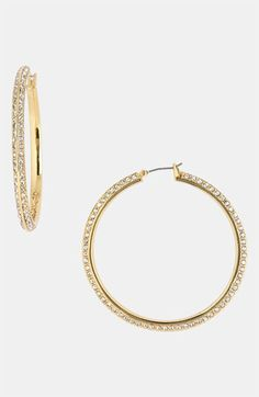 A girl can always count on a pair of hoops to solidify the outfit. It's definitely a staple item in my book! ~ Rivera
