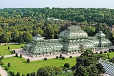 Composed of sheets of glass, the Palm House at Schönbrunn Palace Park in Vienna takes the cake as the largest glass house in continental Europe. Devised by designer Franz von Segenschmid and constructed by metalworker Ignaz Gridl in the it i Architectural Digest, Beautiful Architecture, Beautiful Buildings, Architecture Design, Victorian Greenhouses, Most Beautiful, Beautiful Places, Glass Building, Glass Structure
