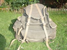 1945 date stamped WWII British commando bergen, green with two front ammo pouches, bottom straps, fixed side straps, removable side straps, black rubberised lining is still very much weather proof.   eBay!