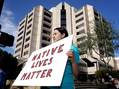 PHOENIX — A small group in Arizona on Monday protested a decision not to charge a police officer in the shooting...