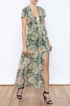 The Flawless Maxi Dress features an allover geometric paisley print, plunging neckline, and a thigh high slit. Lined with a tie around the waist and a hidden side zipper closure.   Flawless Dress by WYLDR . Clothing - Dresses - Printed Clothing - Dresses - Maxi Clothing - Dresses - Short Sleeve Miami, Florida