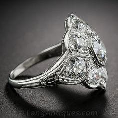 This classic 'cigar band' style ring from the roaring 20's glitters and gleams with nine bright-white high-voltage old mine-cut diamonds, together weighing 3.35 carats. This dazzling Jazz Age jewel is hand crafted in platinum and is artfully shaped to hug your finger with beautiful diamonds flashing in all directions. The top measures just shy of 3/4 inch; ring size 4 3/4.