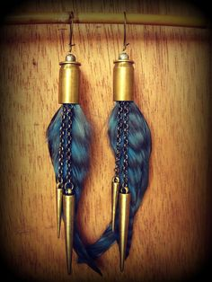 Bullets Blue chinchilla rooster feathers and gold by boogiebazaar Ammo Jewelry, Brass Jewelry, Gothic Jewelry, Leather Jewelry, Leather Bracelets, Leather Cuffs, Jewelry Necklaces, Bullet Casing Jewelry, Bullet Earrings