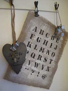 Piece of Burlap...painted & stamped with the alphabet...hung with a metal clip onto a hook.