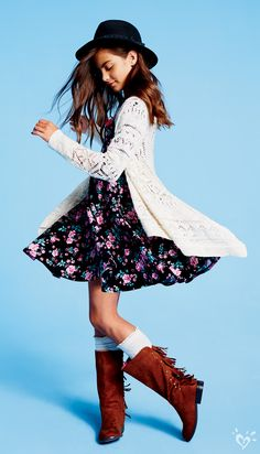 For it-girl style, layer a crochet waterfall cardigan over a floral flare dress and factor in fringe boots.