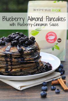 Blueberry Almond Pancakes with Blueberry-Cinnamon Sauce - a healthful and tasty breakfast packed with nuts, fruit and whole-grain flour. | foxeslovelemons.com
