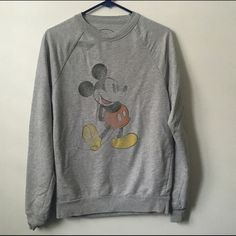 Disney Crewneck Faded Mickey Mouse Crewneck! Worn a few times but in good condition! No stains or rips. Labeled size small but could fit a medium as well! Disney Sweaters Crew & Scoop Necks
