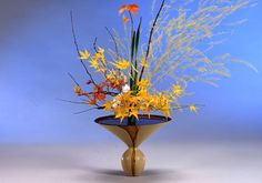 Ikebana, one of the traditional arts of Japan, has been practiced for more than 600 years. It developed from the Buddhist ritual of offering flowers to the spirits of the dead. By the middle of the fifteenthcentury, with the emergence of the first classical styles, Ikebana achieved thestatus of an art form independent of its religious origins, though it continued to retain strong symbolic and philosophical overtones. The first teachers and students were priests and members of the nobility. However, as time passed, many different schools arose, styles changed, and Ikebana came to be practiced at all levels of Japanese society.