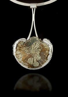 Ocean Trinket Pendant: Pyritized sand dollar and sterling silver. Handmade By Cynthia Downs. | via cynthiadowns.com