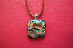 Multicolored dichroic glass pendant by Ivy Tree Designs. $18.80