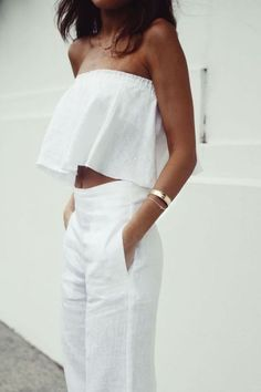 Matching two white linen set. High waisted linen pants with crop top, off the shoulder top. Simple outfit that can be dressed up or be more casual. Easily paired for with gold or silver bracelets, necklaces, rings, etc. Light weight material makes for the perfect summer or spring outfit.
