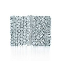 Tiffany & Co. -  Wide Diamond Bracelet: A Deco-inspired bracelet of diamonds in platinum. Carat total weight, diamonds: round brilliant, 22.28; baguette, 19.62; square, 3.05; trilliant, .73.