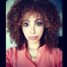 Shoulder length dark curly hairstyle with red highlights