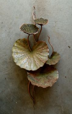Lotus pods & leaves wall flower. $385.00, via Etsy.