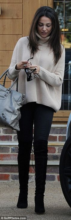 Dressed up: The pretty brunette looked cute in a beige roll-neck jumper, black skinny jean...