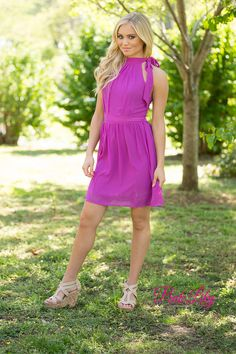 This gorgeous purple dress is perfect for a day of shopping and afternoon adventures! There's some adorable pleating on the skirt and bodice, while the halter top has a cute fabric tie! There's also a low cut back and a zipper as well.