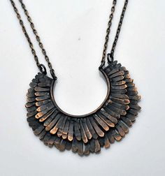 """A THOUSAND FACETS HOLIDAY GIFT GUIDE  FILOMENA DE MARCO  Texture bronze wire to form the shape of a Mohawk. Necklace hangs on a blackened brass chain and can be ordered in 16, 18, and 20"""" lengths. 2"""" wide   Price $75.00  Filomena will be offering 10% off your purchase on Cyber Monday with tthe coupon code: SPECIAL10"""