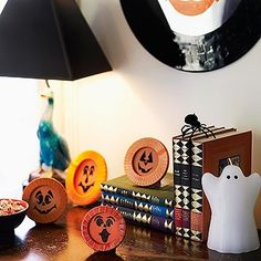 Decorate your home office with smiling orange pumpkins.