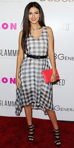Love Her Outfit! Star Style to Steal | VICTORIA JUSTICE | Gingham is one of spring's hottest prints, but it can trend saccharine without careful styling. The actress gives her BCBGeneration dress a little edge with chunky heels by the line and a silver choker, then adds a Kate Spade New York clutch and matching lip for a pop of color.