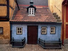 "Golden Lane ""Lilliputian lodging, this little blue house lines Golden Lane, a cobblestone street in the Prague Castle complex that was fashioned as a residential area for the Emperor's marksmen."""
