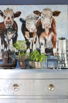 Remember the longhorn painting in the kids' room of HGTV Smart Home 2015? We're keeping the tradition of great animal art in HGTV home giveaways alive with cows! Aren't these guys adorable?! Painted by a local artist, they hang over an industrial steel console that bridges the dining room and kitchen. >> http://www.hgtv.com/design/hgtv-urban-oasis/2015/dining-room-pictures-from-hgtv-urban-oasis-2015-pictures?soc=pinterest