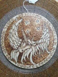 Wooden circle decorated with pyrography-unicorn