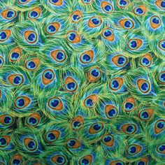 PEACOCK FEATHER PLUME Fabric - Quilt Fabric 1 Yard - Turquoise Jade Peacocks Feathers Blue Green. $9.99, via Etsy.
