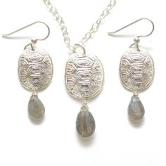 Loksi Earrings and Necklace Set by Chickasaw metalsmith artist Kristen Dorsey.