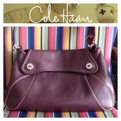 "COLE HAAN Dark Plum with Pink Trim Leather Bag Beautiful pebbled leather hobo style in excellent condition. Magnetic Silvertone clasps. The dimensions are 8 1/2"" Tall..14 1/2"" Wide at the widest...4 1/2"" Deep at the deepest with a 10 1/2"" Drop. Cole Haan Bags Hobos"