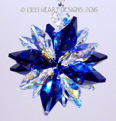 Swarovski Crystal Suncatcher Car Charm Cobalt Blue and Aurora Borealis Star https://www.etsy.com/listing/271071647/mw-swarovski-crystal-mini-super-star