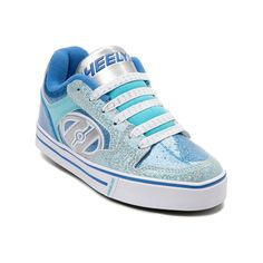 Why walk, when you can get on a roll with the new Motion Glitter Skate Shoe from Heelys! The Motion Glitter Skate Shoe sports a low-top design constructed with metallic patent uppers, plush lining for comfort, and removable wheels to convert from skate to sneaker. <b>Available for shipment in May; Pre-order yours today!</b>  <br><br><u>Features include</u>:<br> > Synthetic metallic upper with breathable textile lining<br> > Lace closure ensures a secure fit<br> > Padded tongue and collar…