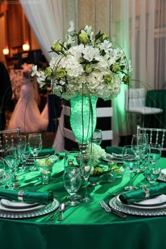 Green and white palette centerpiece at the Sawgrass Bridal Show.