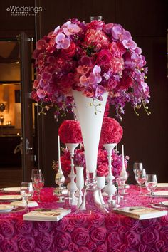 Beautiful red, purple, and pink Wedding Decor by Flora & Eventi