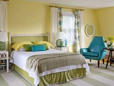 fresh, bright bedroom - light yellow walls, white ceiling/trim, light wood floor; celery green, taupe, yellow white bed linens; pops of teal