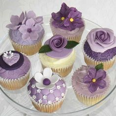 cupcakes I like these. Instead of little cakes around wedding cake or maybe on our Candy Table