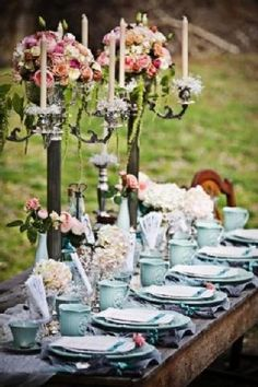 Tablescape and centerpiece. Those candlesticks are amazing with this. Makes me want to have a tea party too.